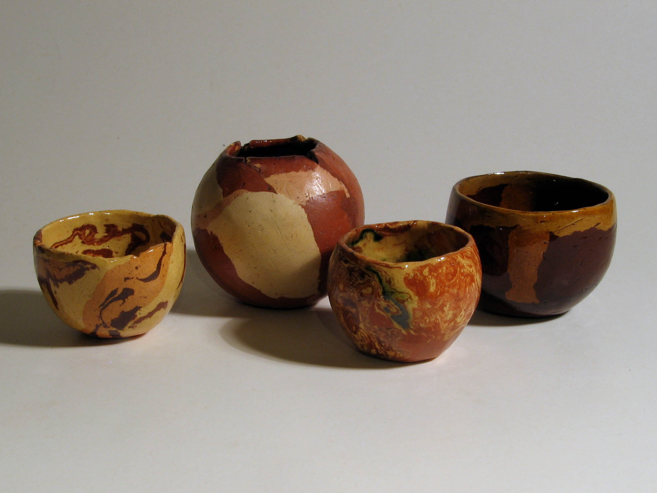 Coloured clay pinch pots